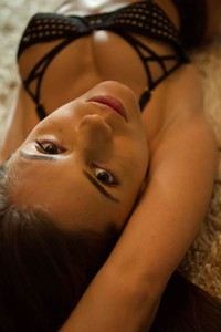 Dazzling beauty in black lingerie Caprice plays with her toys on the floor