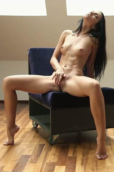 Beautiful Sapphira steps in the nude and plays with her sweet pussy